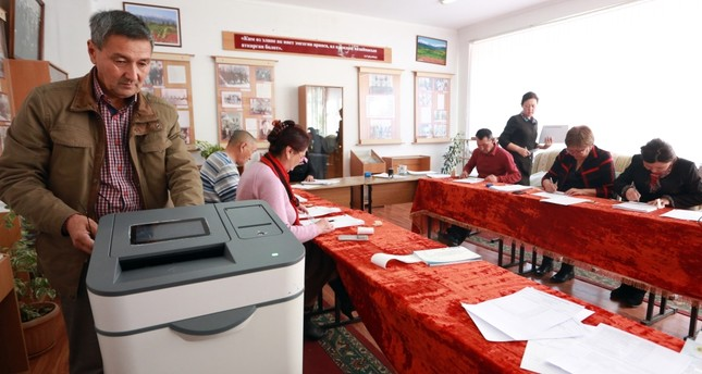 Members of the election commission prepare a polling station for the presidential election in the village of Baytik near Bishkek, Kyrgyzstan, Oct. 13.