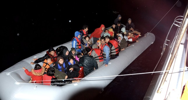 Illegal migrants intercepted at sea being pulled to a Coast Guard boat off the coast of İzmir, Oct. 7, 2019.