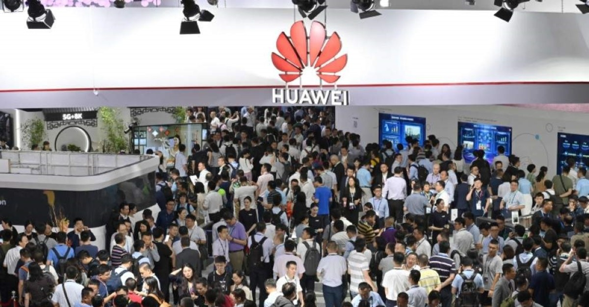 People visiting a Huawei stand during the Mobile World Congress (MWC 2019) introducing next-generation technology at the Shanghai New International Expo Center (SNIEC) in Shanghai. (AFP Photo)