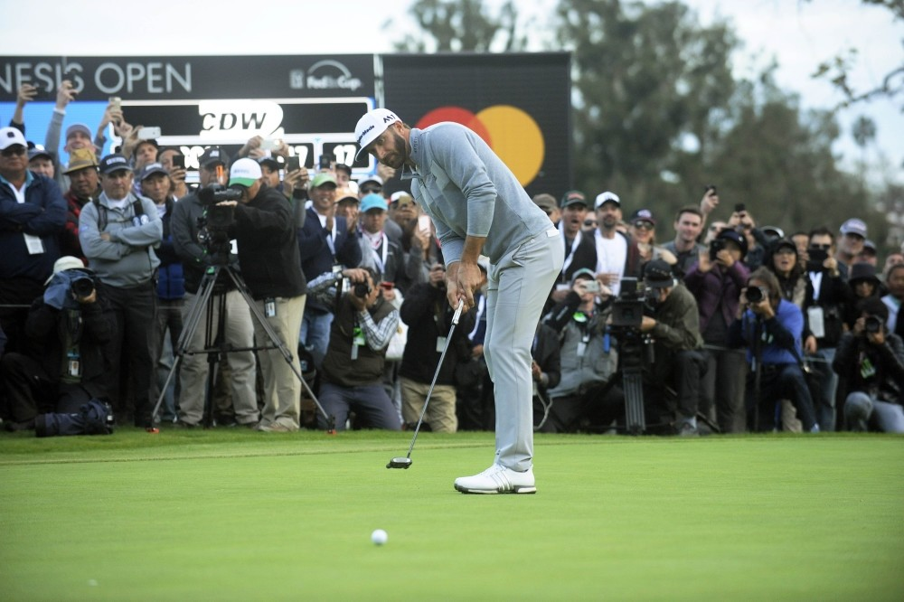 Dustin Johnson puts on the 18th hole green during the final round of the Genesis Open golf tournament at the Riviera Country Club.