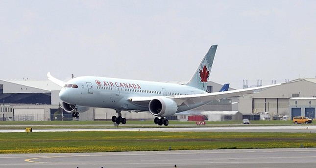 Air Canada's Boeing 787 Dreamliner taxis towards a hangar after landing at Pearson International Airport in Toronto (Reuters File Photo)