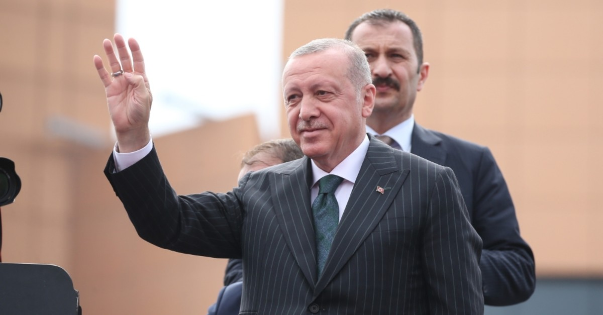 President Recep Tayyip Erdou011fan waves at people in Istanbul, June 20, 2019.