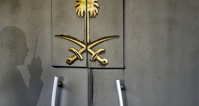 A shadow of a security member of the consulate is seen on the door of the Saudi Arabian consulate on November 1, 2018 in Istanbul. (AFP Photo)