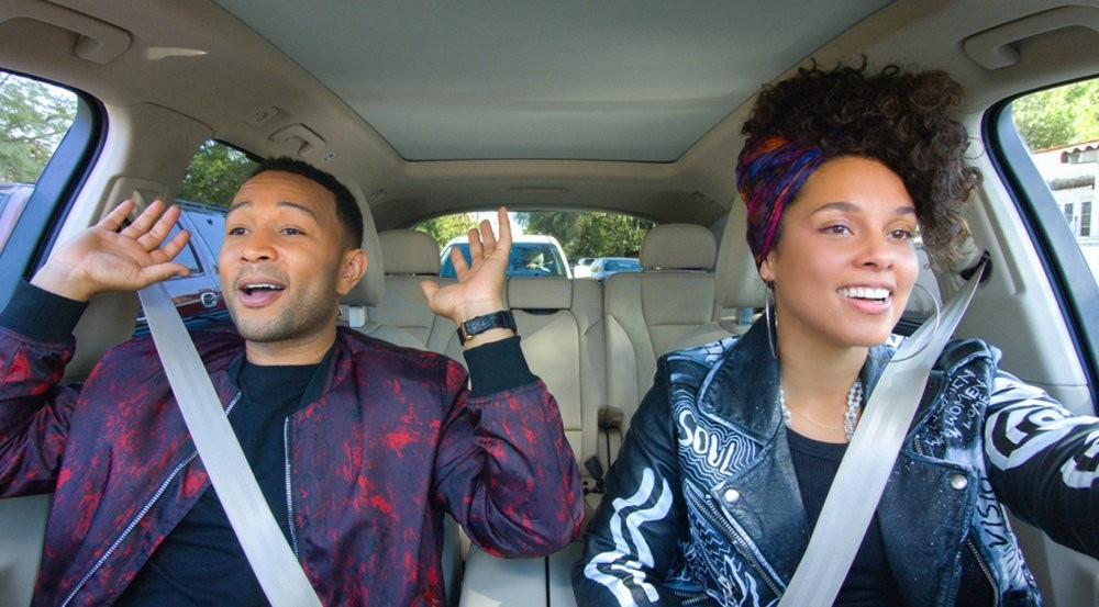 Recording artists John Legend (L) and Alicia Keys are shown during the taping of a new episode of Carpool Karaoke: The Series, available on Apple Music since Aug. 8.