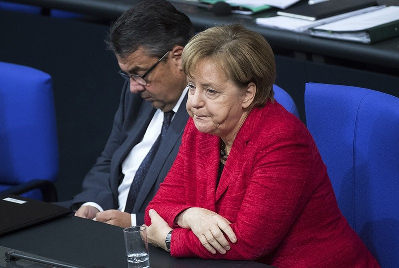 German Chancellor Angela Merkel, right, and German Foreign Minister Sigmar Gabriel attend a plenary session of German parliament Bundestag in Berlin, Tuesday, Nov. 21, 2017. (AP Photo)