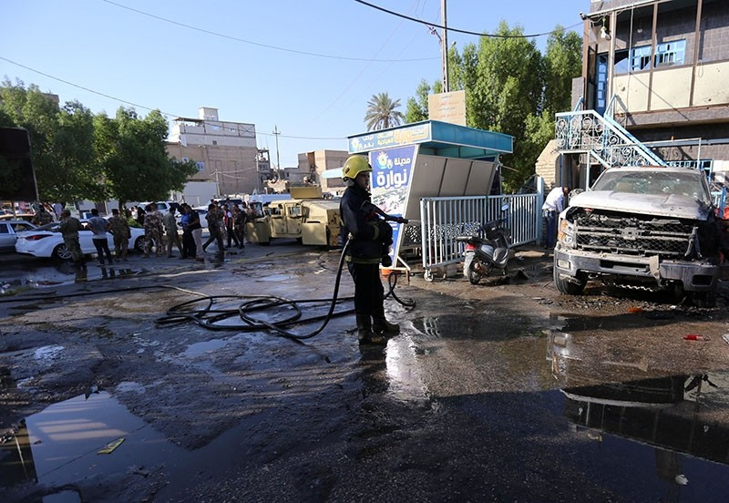 A woman detonated her explosive belt in a market east of the Shiite holy city of Karbala on Friday, killing at least 30 and wounding 35, Iraqi security sources said. (Reuters Photo)