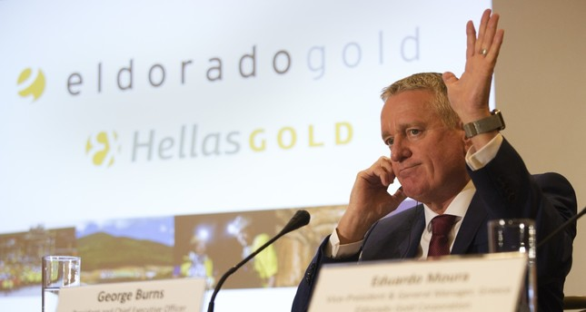 Eldorado President and CEO George Burns gestures during a news conference in Athens. Canadian mining company Eldorado Gold threatened to suspend a major investment in Greece in ten days, accusing the government of delaying permits and licenses.