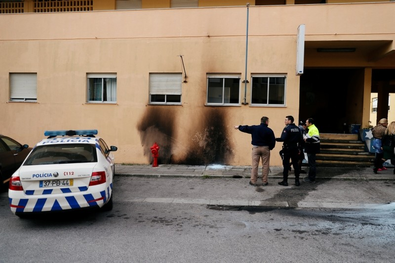 The police officers are seen near the damage caused by molotov cocktails is seen on the police station building at the Bela Vista neighborhood in Setubal, Portugal January 22, 2019. (Reuters Photo)