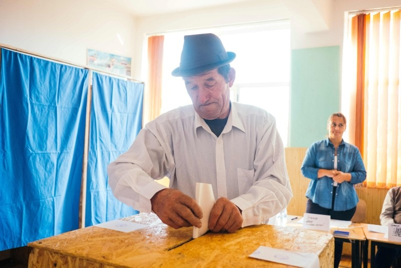 A man casts his vote on October 6, 2018, in Darasti, Romania. (AFP Photo)