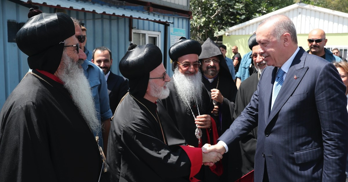 President Recep Tayyip Erdou011fan shakes hand with the priests of the Assyrian Orthodox Church during the foundation laying ceremony of Mor Ephrem (Saint Ephraim) Syriac Church in Istanbul, Aug. 16, 2019.