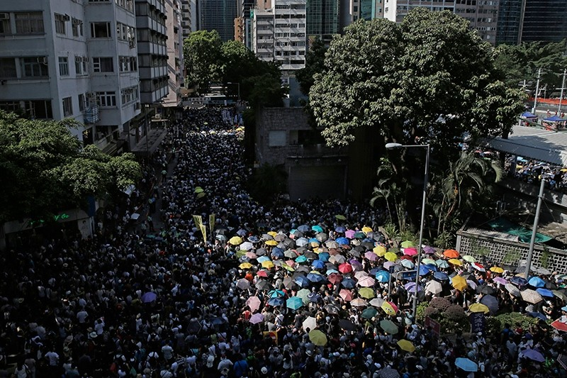 Protesters attend a rally to support young activists Joshua Wong, Nathan Law and Alex Chow in downtown Hong Kong Sunday, Aug. 20, 2017. (AP Photo)
