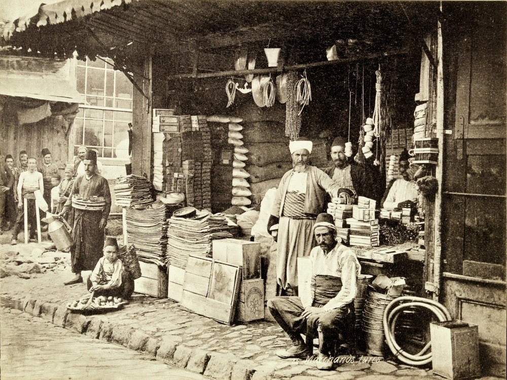 Ottoman tradesmen posing for the camera in front of a grocery store.