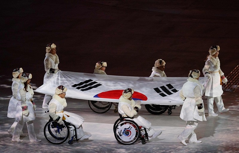 Flag bearers enter with the South Korean flag during the opening ceremony of the Pyeongchang 2018 Winter Paralympic Games at the Pyeongchang Stadium on March 9, 2018. (AFP Photo)