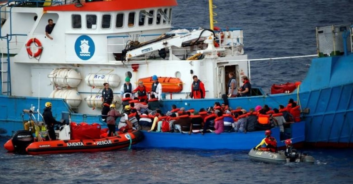 Migrants on a wooden boat are rescued by German NGO Jugend Rettet ship ,Juventa, crew in the Mediterranean sea off Libya coast, June 18, 2017. (Reuters Photo)