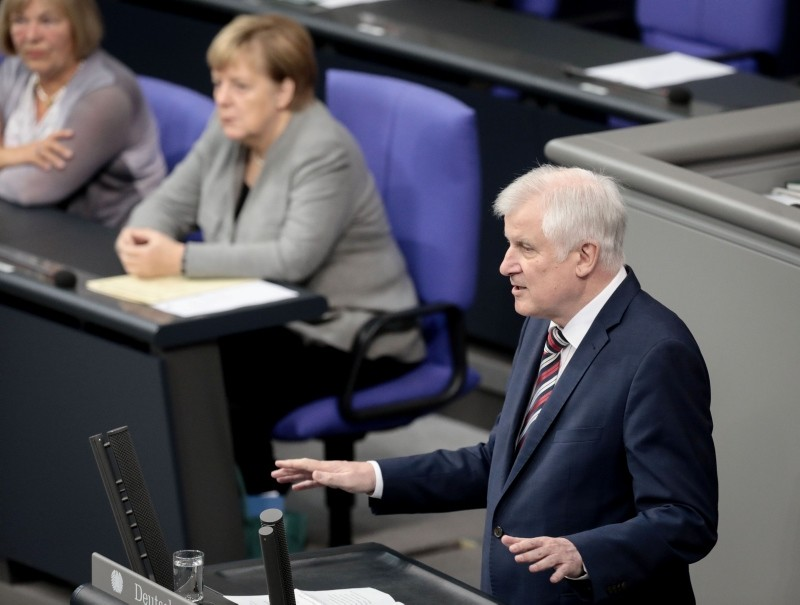 German Interior Minister Horst Seehofer gives a speech during a sitting of the Bundestag, Germany's lower house of parliament, on the 2019 federal state budget in Berlin on September 13, 2018. (AFP Photo)