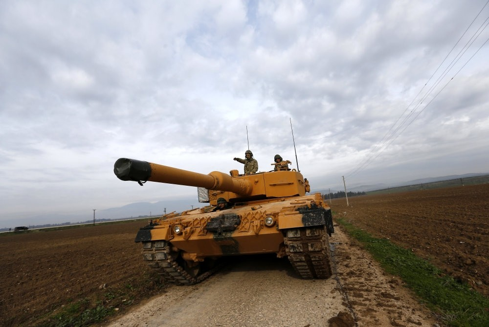 Turkish soldiers on their tanks near the Turkish-Syrian border in the Reyhanli district of southern Hatay province on Jan. 21 as part of Operation Olive Branch, which was launched on Jan. 20 and ended on March 18.
