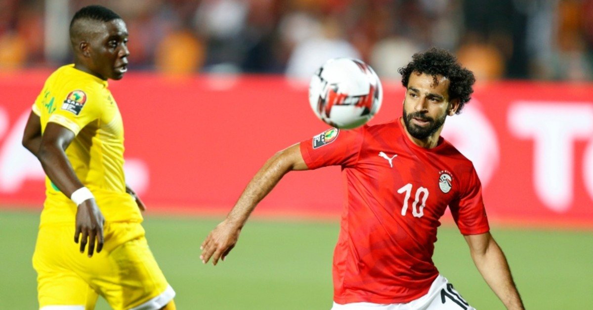 Egypt's Mohamed Salah runs with the ball during the group A football match between Egypt and Zimbabwe, the opening match of the Africa Cup of Nations at Cairo International Stadium in Cairo, Egypt, Friday, June 21, 2019. (AP Photo)