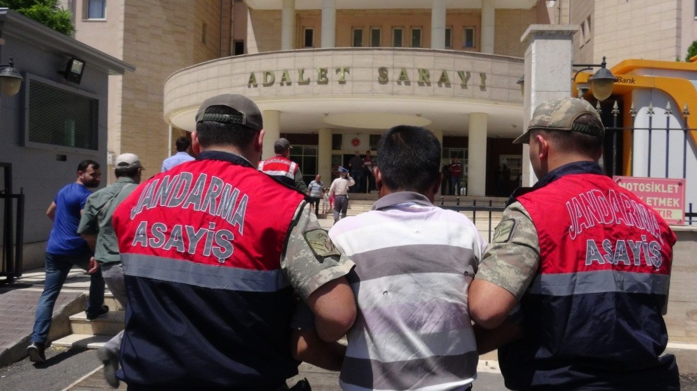 Gendarmerie officers escort M.M. to the courthouse in u015eanlu0131urfa. Daesh militant was captured in the province after infiltrating into Turkey from Syria.