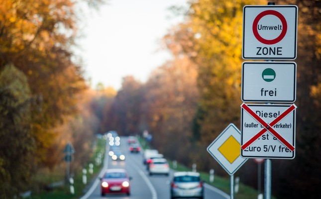 Signs on road point to a planned driving bans for older diesel vehicles in Stuttgart, Germany, Nov. 9, 2018.