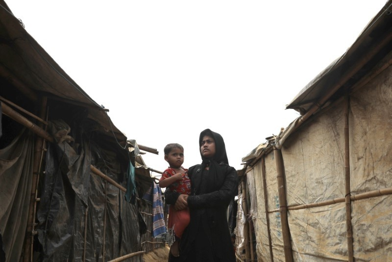 A Rohingya woman with her child at the Kutupalong camp, Coxu2019s Bazar, Bangladesh, March 25.