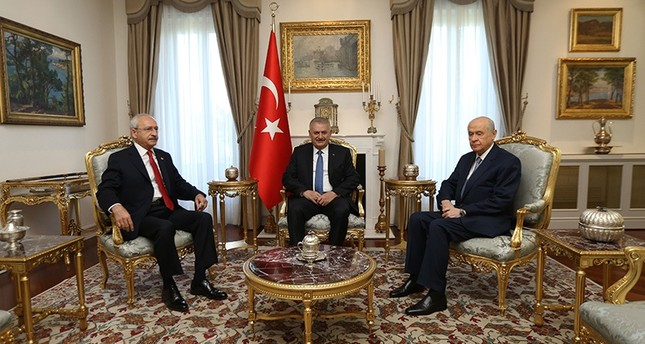 PM Binali Yıldırım (C) met with CHP's Kemal Kılıçdaroğlu (L) and MHP's Devlet Bahçeli in Çankaya Prime Ministry Office in Ankara on Monday. (AA Photo)