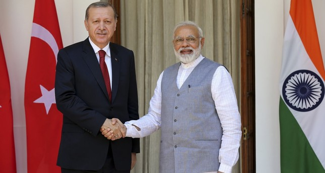 Turkish President Recep Tayyip Erdoğan L and Indian Prime Minister Narendra Modi R shake hands upon their arrival at Hyderabad House prior to their meeting in New Delhi, India, May 1 2017.