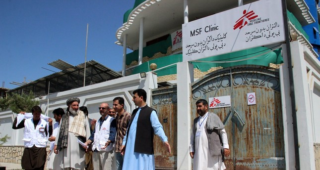 Hospital staff of Medecins Sans Frontiers (MSF) stand outside the MSF clinic in Kunduz, Afghanistan, 22 July 2017. (EPA Photo)