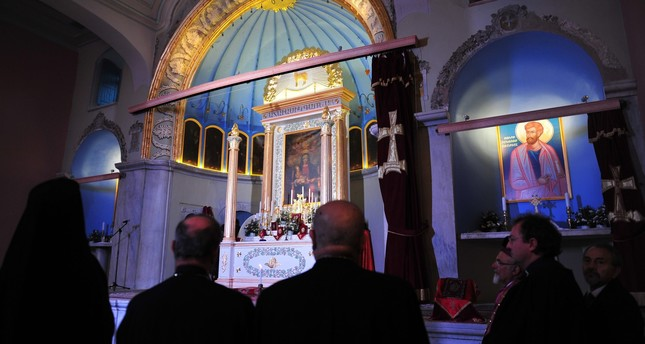 Believers pray during a mass at the Surp Vortvots Vorodman, an Armenian Church in the Kumpapı district of Istanbul.
