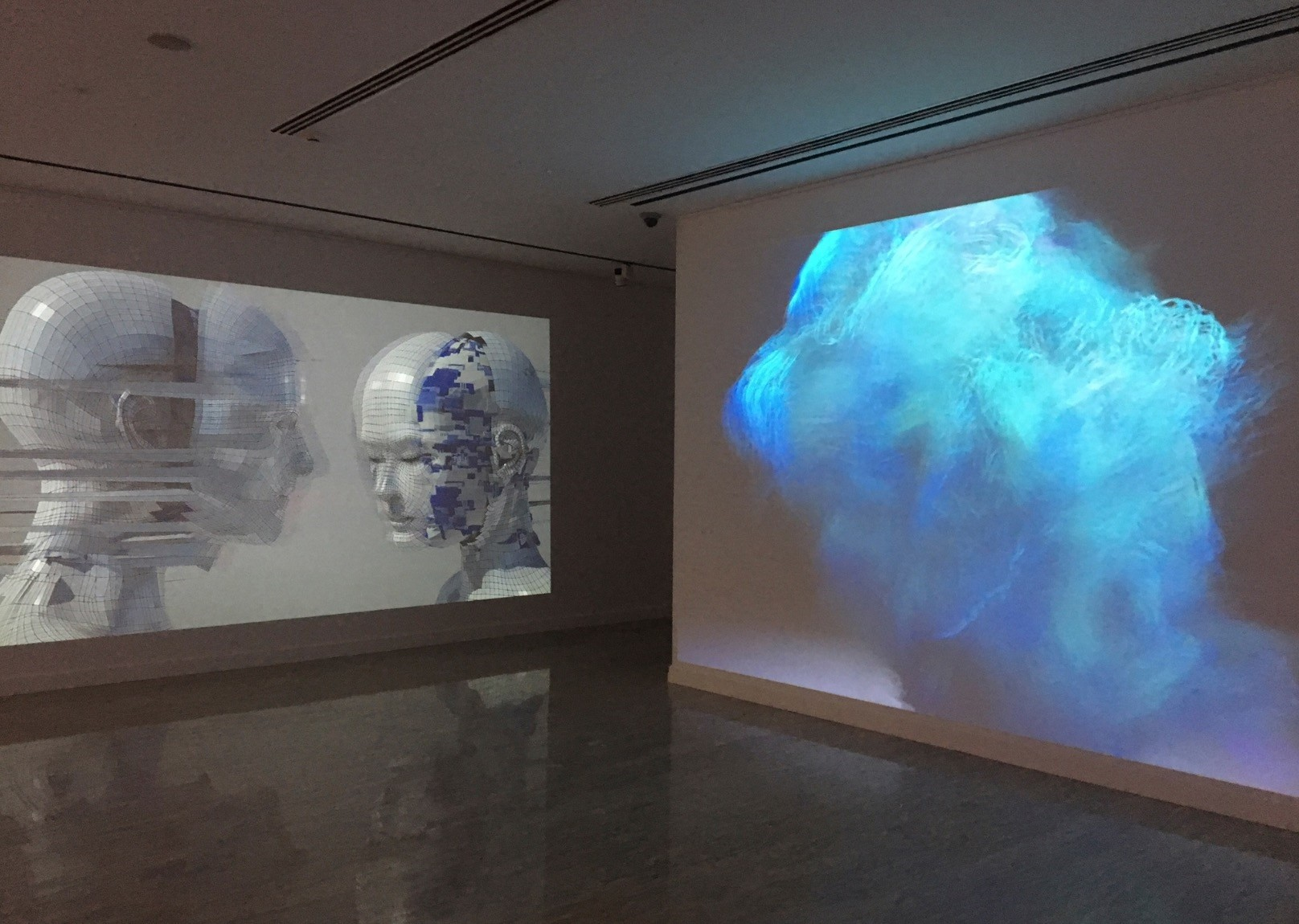 u201cUntitled Fur Suitu201d by A Bill Miller plays at the center projection screen in tufts of soft and pacifying virtual textures with Elena Romenkovau2019s u201cTwo 20001_1.u201d