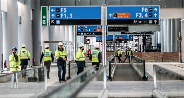 Construction workers inspect one of the terminals at the Istanbul New Airport, which officials say is 80 percent complete.