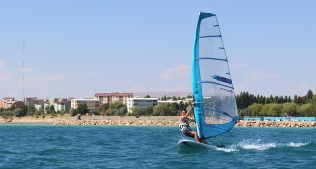 Windsurfers enjoy the summer breeze on Lake Van.