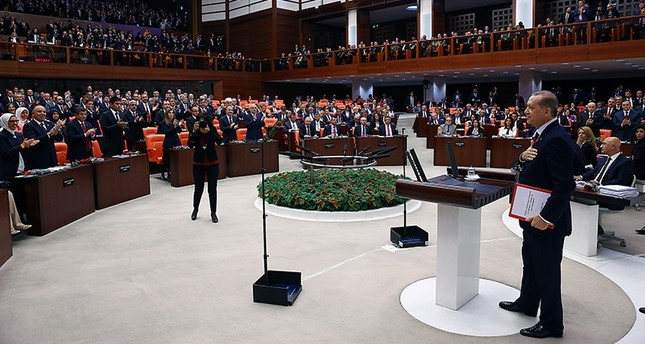 President Erdoğan approaches to the rostrum at the Parliament to make his address for the first session of the new legislative year. (AA Photo)