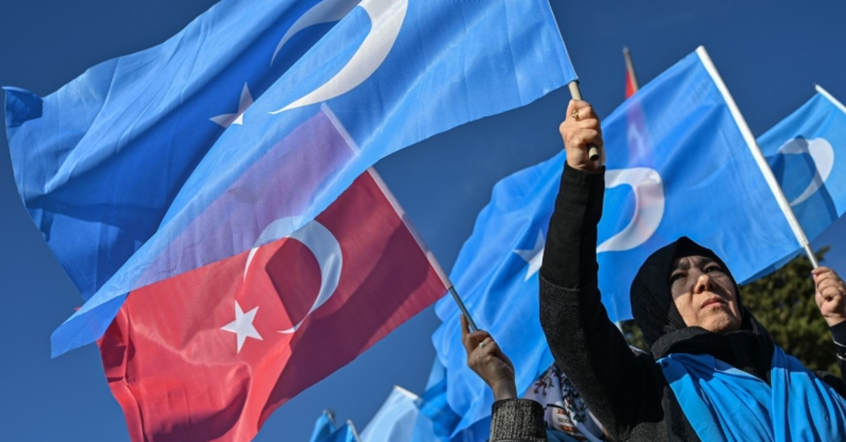 Supporters of China's Muslim Uighur minority wave flags of East Turkestan and Turkey during a demonstration at Beyazu0131t square in Istanbul on December 14, 2019. (AFP Photo)