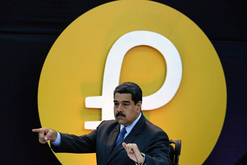 Venezuela's President Nicolas Maduro gestures during a press conference to launch a new oil-backed cryptocurrency called u2018Petro', at the Miraflores Presidential Palace in Caracas.