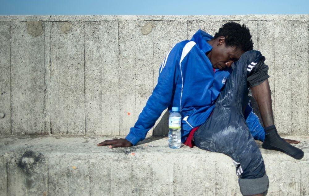 A migrant rests after arriving aboard a coast guard boat at Algecira's harbor, July 14.