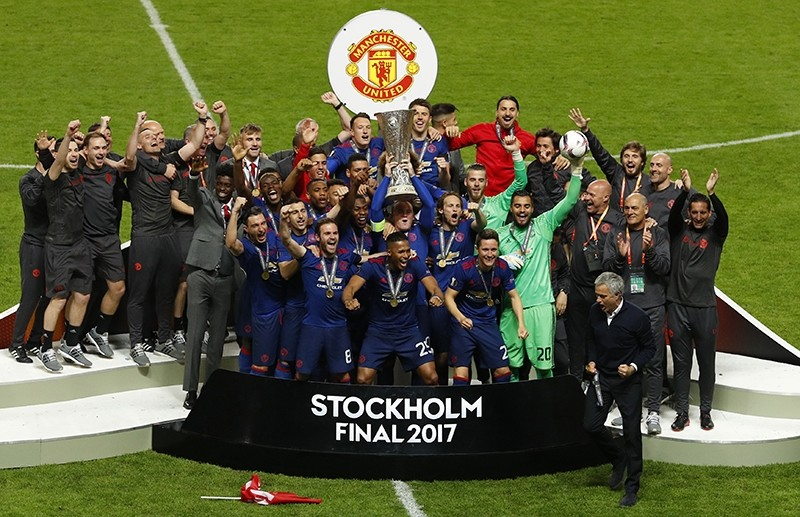 United players celebrate after winning the soccer Europa League final between Ajax Amsterdam and Manchester United at the Friends Arena in Stockholm. (REUTERS Photo)