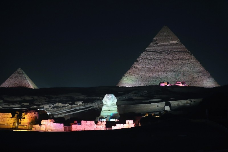 The Sphnix is lit up in front of the Great Pyramids during the Sound and Light show at the Giza Pyramids plateau, in Giza, Egypt, 29 October 2018 (EPA file photo)