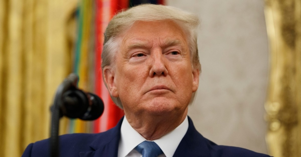U.S. President Donald Trump pauses before speaking during a ceremony to present the Presidential Medal of Freedom to former Attorney General Edwin Meese, in the Oval Office of the White House, Tuesday, Oct. 8, 2019, in Washington. (AP Photo)