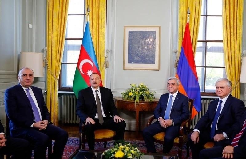 Azerbaijan's Foreign Minister Elmar Mammadyarov, Azerbaijan President Ilham Heydar Oglu Aliyev, Armenian President Serzh Sargsyan and Armenia's Foreign Minister Edward Nalbandian pose during talks in Geneva, Switzerland, Oct. 16, 2017. (AFP Photo)