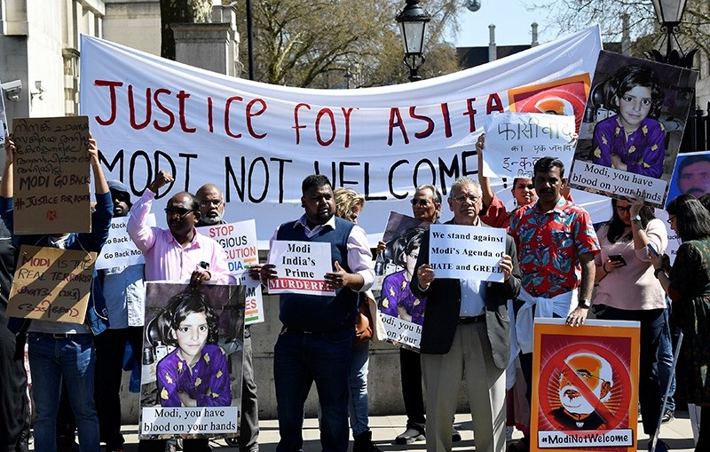 Demonstrator holds a placards and pictures of India's Prime Minister Narendra Modi in Parliament Square, London, Britain, April 18, 2018. (Reuters Photo)