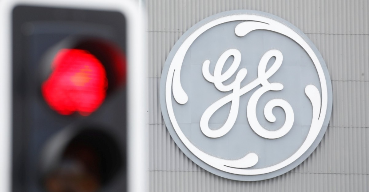 A traffic light is seen in front of a logo of General Electric at the company's plant in Birr, Switzerland June 17, 2019. (Reuters Photo)