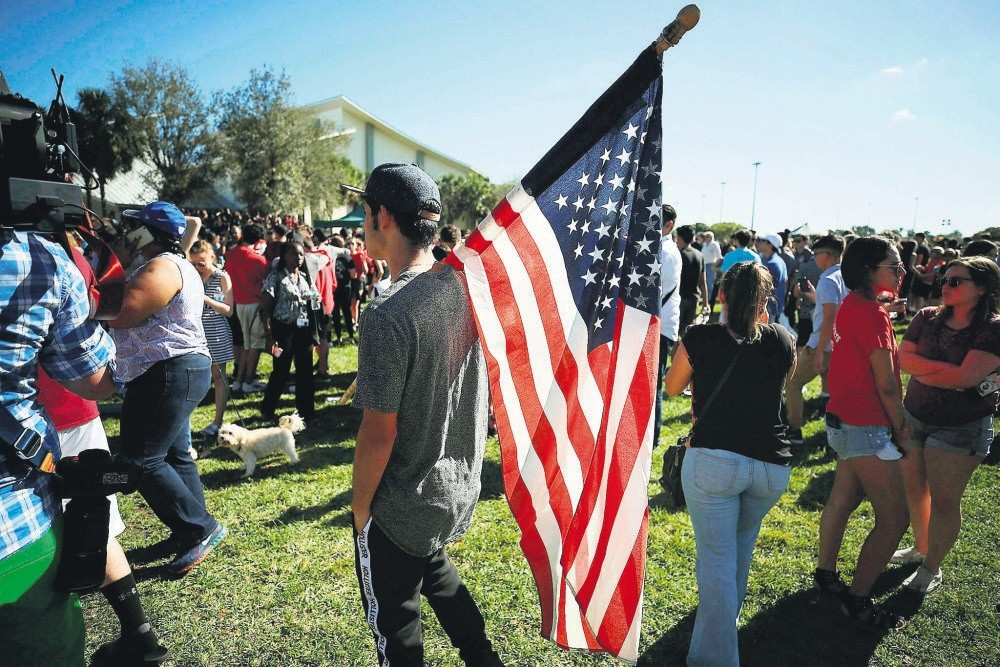 Students of Marjory Stoneman Douglas High School gather at Pine Trail Park, Florida, Feb. 15.