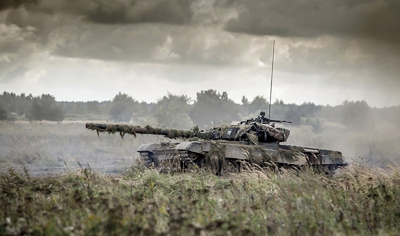 In this picture publicly provided by the Polish Armed Forces General Command a tank takes part in the Dragon 17 exercise in Drawsko Pomorskie, Poland, Wednesday, Sept. 21, 2017. (AP Photo)