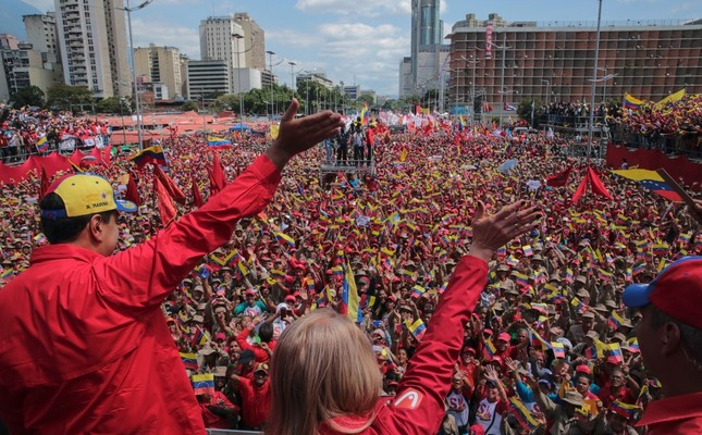 Venezuelan President Nicolas Maduro L and his wife Cilia Flores wave at the crowd during a gathering to mark the 20th anniversary of the rise of power of the late Hugo Chavez, in Caracas, Feb. 2, 2019.