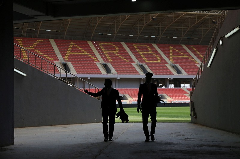 Two men walk inside the Karbala Olympic Stadium in Karbala, central Iraq, on April 4, 2018. (AFP Photo)