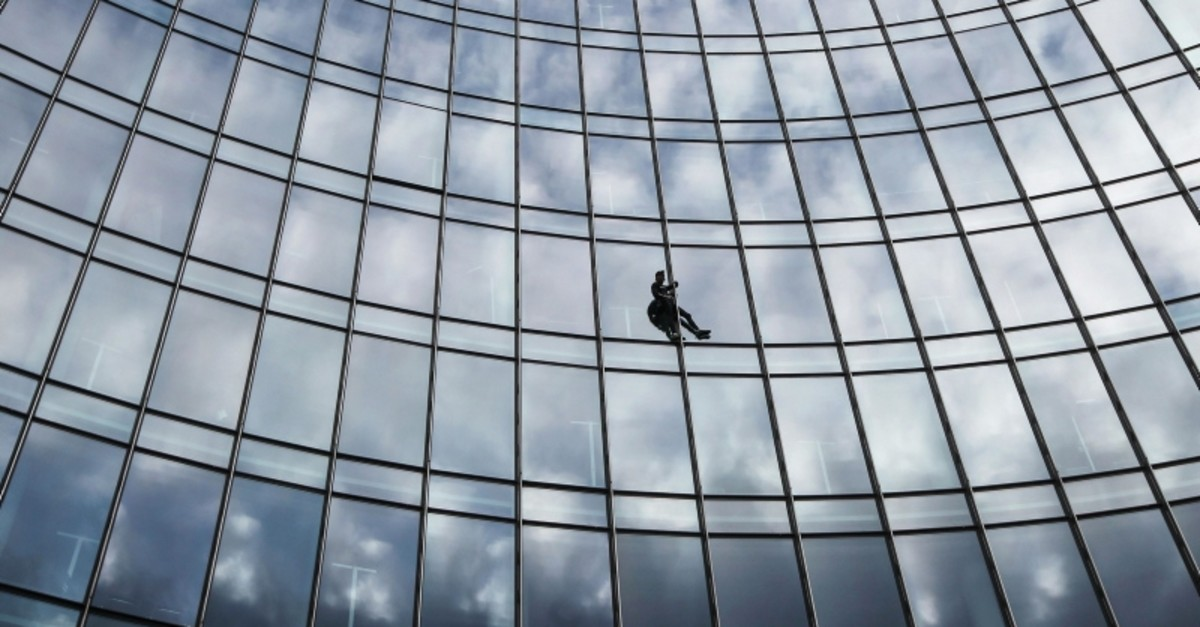French urban climber Alain Robert, popularly known as the ,French Spiderman,, climbs the XYZ building in Frankfurt am Main, on September 28, 2019. (Reuters Photo)