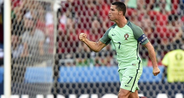 Cristiano Ronaldo of Portugal celebrates after scoring a goal during the UEFA EURO 2016 group F preliminary round match between Hungary and Portugal at Stade de Lyon in Lyon, France, 22 June 2016 (EPA Photo)