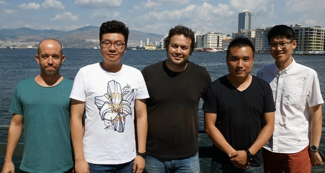 Zhang Nan (L), Yusuf Saygı (C) and Wang Le
