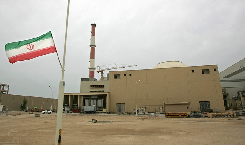 File picture dated April 3, 2007 shows an Iranian flag outside the building housing the reactor of the Bushehr nuclear power plant in the southern Iranian port town of Bushehr, 1200 Kms south of Tehran. (AFP Photo)