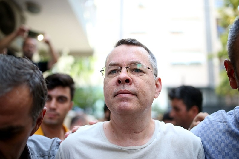 Pastor Andrew Craig Brunson, escorted by Turkish plain clothes police officers as he arrives at his house on July 25, 2018 in Izmir. (AFP Photo)